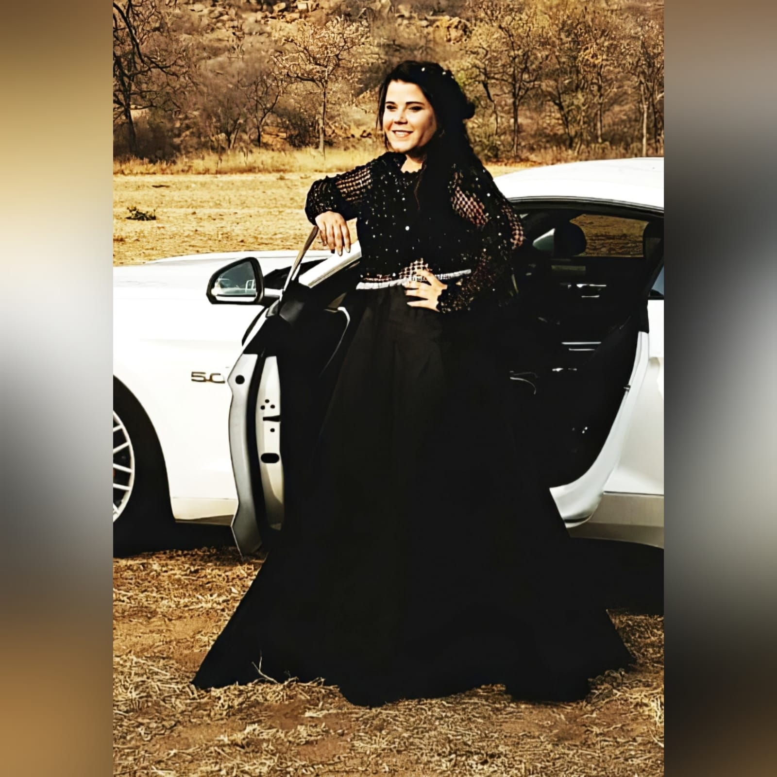 Black matric dress with a lace bodice 1 an elegant design created for a prom night. Black prom dress with a lace bodice with a slight sheer look detailed with silver beads and waist belt. Round neckline and long sleeves bottom flowy in a bridal organza