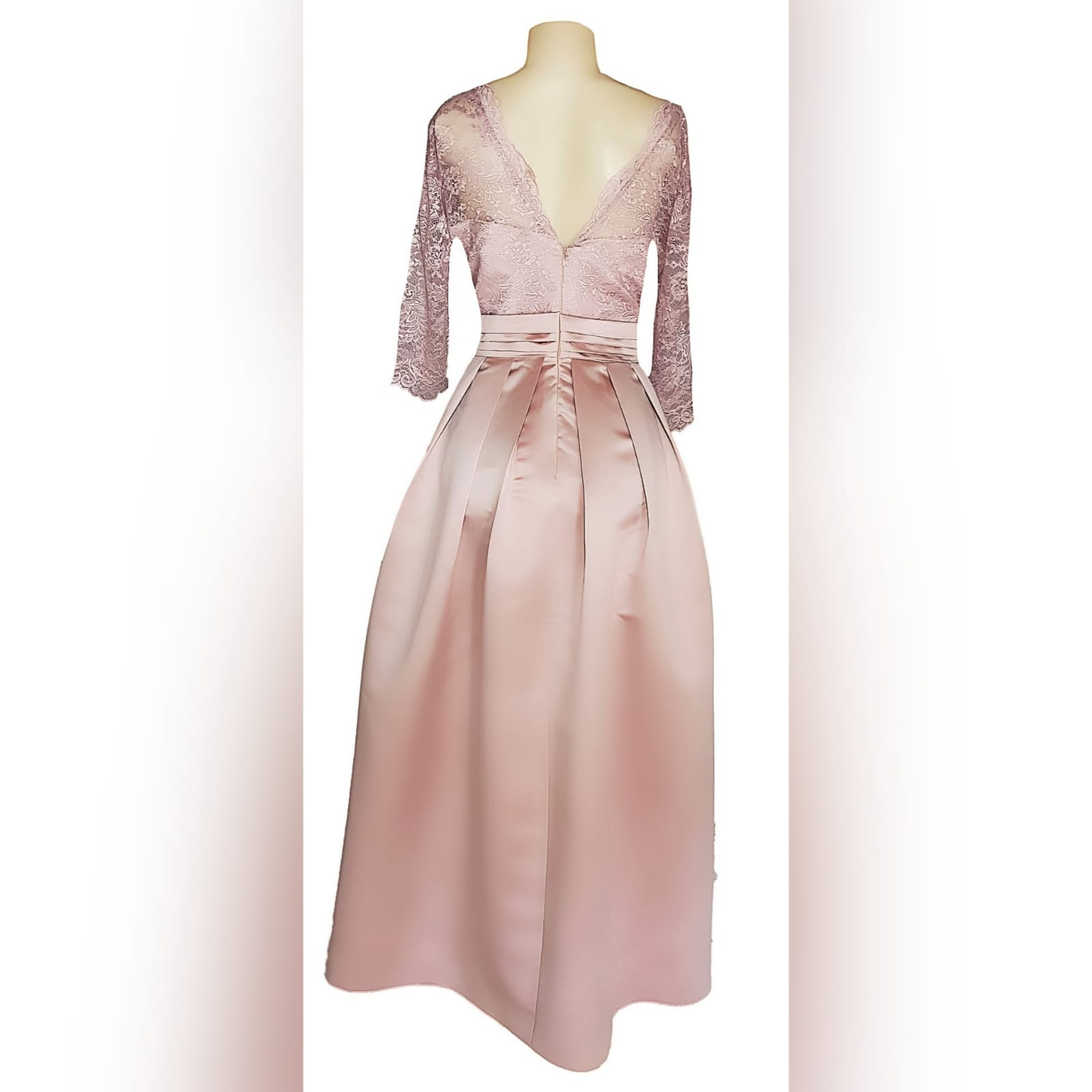 Formal evening dress in dusty pink 5 this dress was created for a wedding ceremony. A formal evening dress in dusty pink. With a lace bodice and 3/4 lace sleeves. With a v neckline. Bottom in a satin, pleated, with a pleated belt and pockets.
