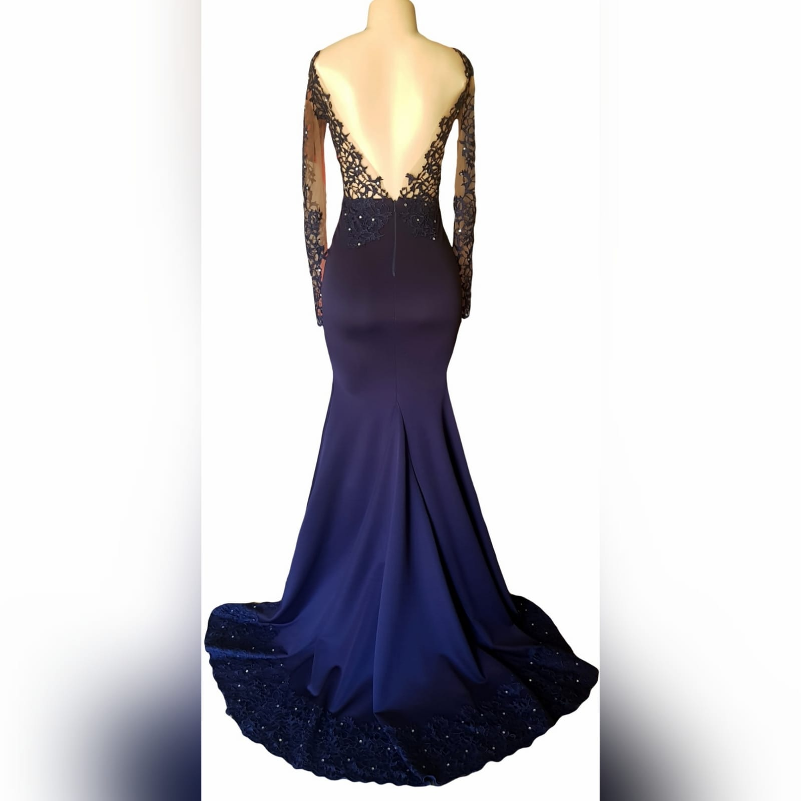 "Custom-designed navy blue mermaid prom dress 10 <em>""a girl should be two things: who and what she wants. ""</em> <em>coco chanel</em> looking stunning on her prom night, she wore a custom-designed and made the dress to fit her like a glove. This navy blue mermaid prom dress has a sheer lace bodice and sleeves, a lace border and scattered silver beads. A dramatic train and a v open back."