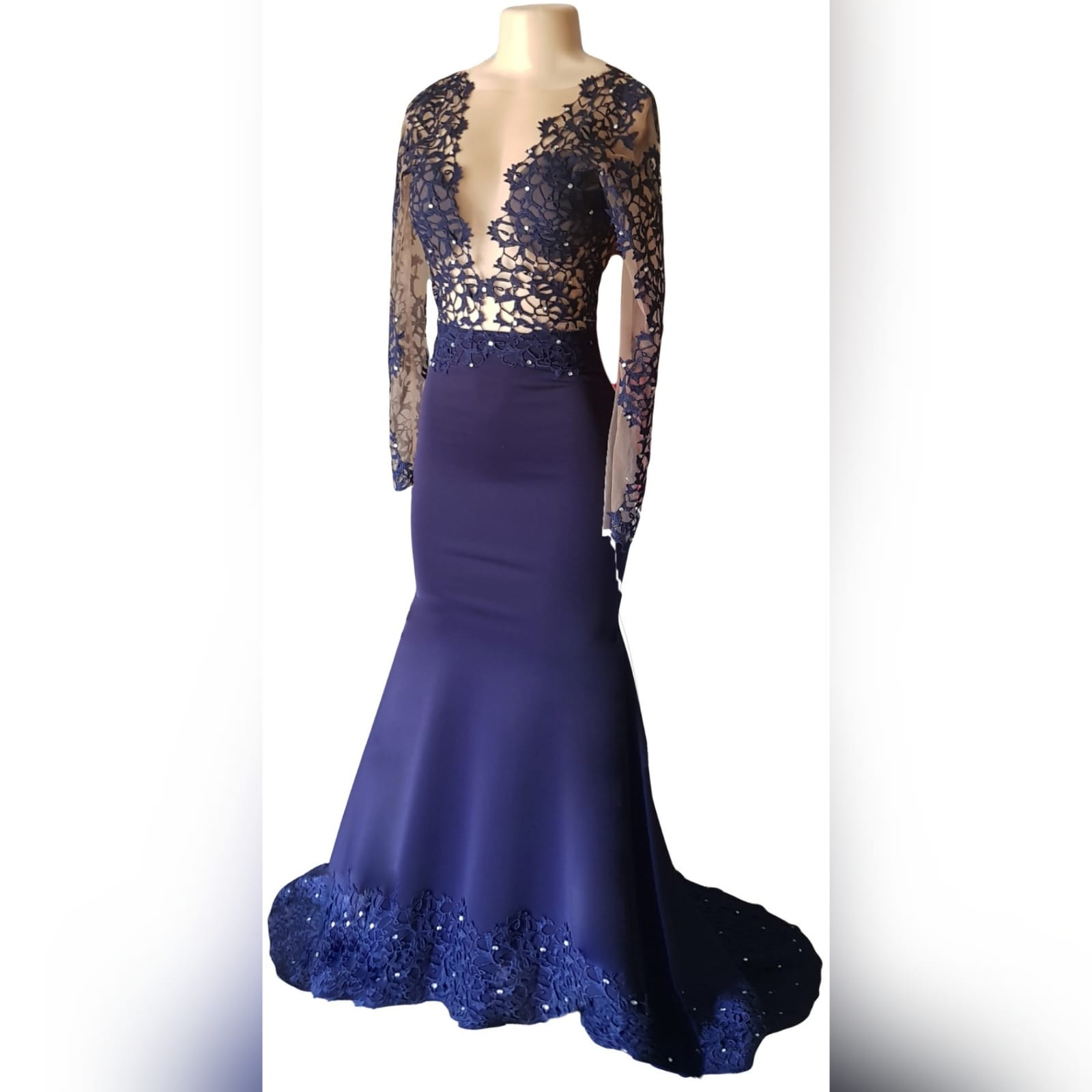 "Custom-designed navy blue mermaid prom dress 8 <em>""a girl should be two things: who and what she wants. ""</em> <em>coco chanel</em> looking stunning on her prom night, she wore a custom-designed and made the dress to fit her like a glove. This navy blue mermaid prom dress has a sheer lace bodice and sleeves, a lace border and scattered silver beads. A dramatic train and a v open back."