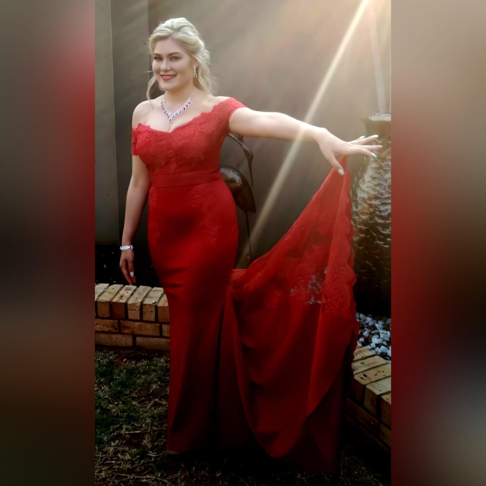 Gorgeous red soft mermaid dress 3 <blockquote><em>you don't have to play masculine to be a strong woman. – mary elizabeth winstead</em></blockquote> a gorgeous red soft mermaid dress created for my client's special event. A dress that turns heads, due to its amazing colour, elegance and sophistication. An off shoulder neckline with off shoulder cap sleeves in lace, with button detail running down the back. A satin belt accentuates the waistline. A wide sheer lace train to add a sensual and dramatic look to the dress.