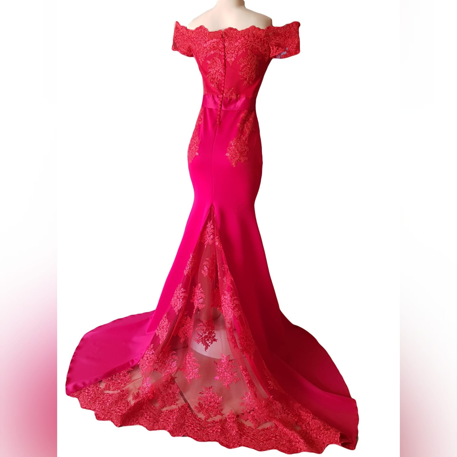 Gorgeous red soft mermaid dress 5 <blockquote><em>you don't have to play masculine to be a strong woman. – mary elizabeth winstead</em></blockquote> a gorgeous red soft mermaid dress created for my client's special event. A dress that turns heads, due to its amazing colour, elegance and sophistication. An off shoulder neckline with off shoulder cap sleeves in lace, with button detail running down the back. A satin belt accentuates the waistline. A wide sheer lace train to add a sensual and dramatic look to the dress.