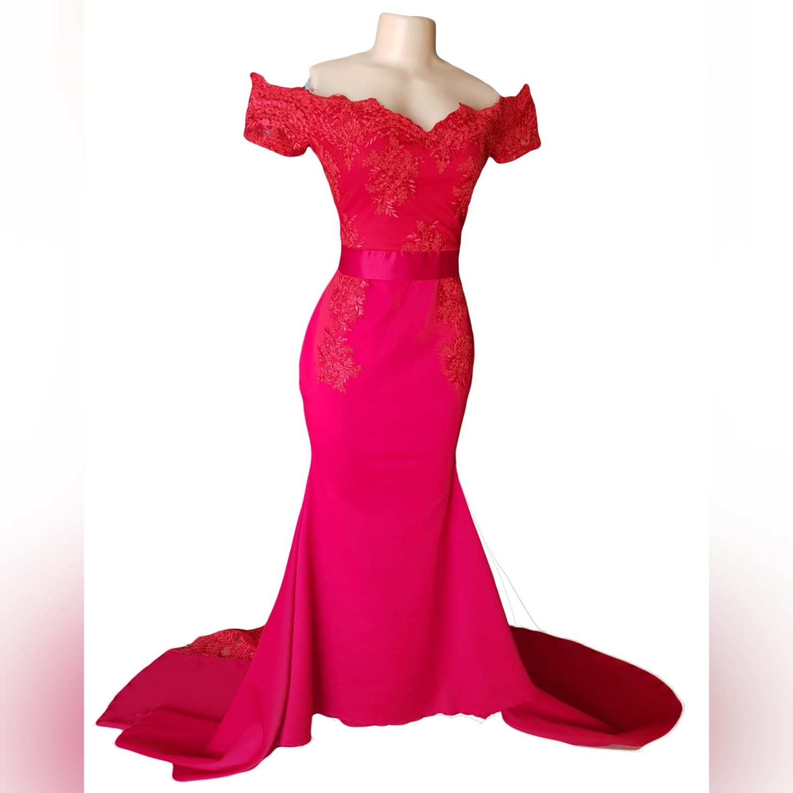Gorgeous red soft mermaid dress 6 <blockquote><em>you don't have to play masculine to be a strong woman. – mary elizabeth winstead</em></blockquote> a gorgeous red soft mermaid dress created for my client's special event. A dress that turns heads, due to its amazing colour, elegance and sophistication. An off shoulder neckline with off shoulder cap sleeves in lace, with button detail running down the back. A satin belt accentuates the waistline. A wide sheer lace train to add a sensual and dramatic look to the dress.
