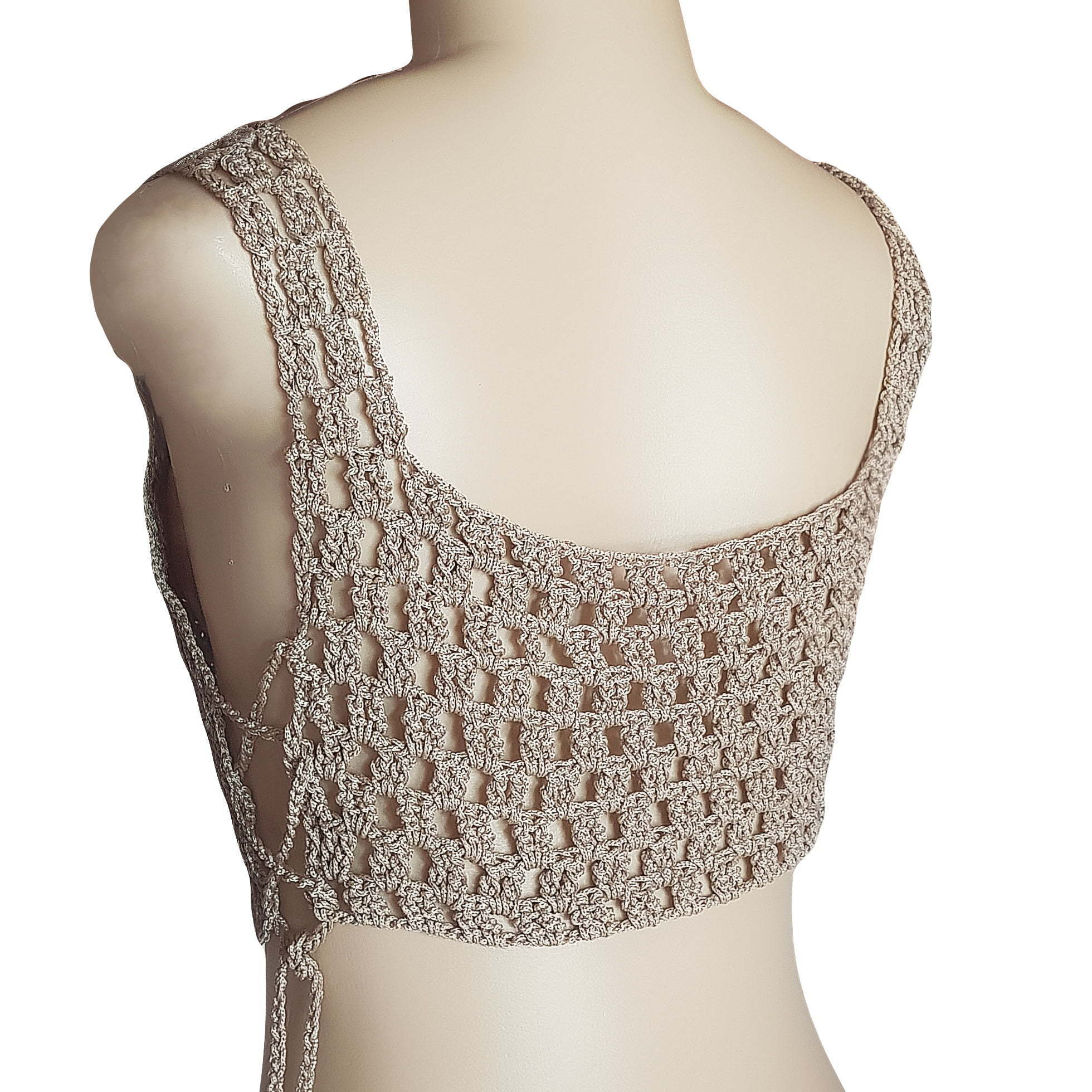 Nude crochet sexy handmade crop top 6 this crochet top was created with comfort and uniqueness in mind. Handmade top created to be a unique one of a kind clothing item. It is perfect for several sizes as you can tie-up the sides looser or tighter for a perfect and comfortable fit. A great crochet top with a modern color. Great as a casual top or with smart pants or a skirt, accessories and shoes for a more smart casual occasion.