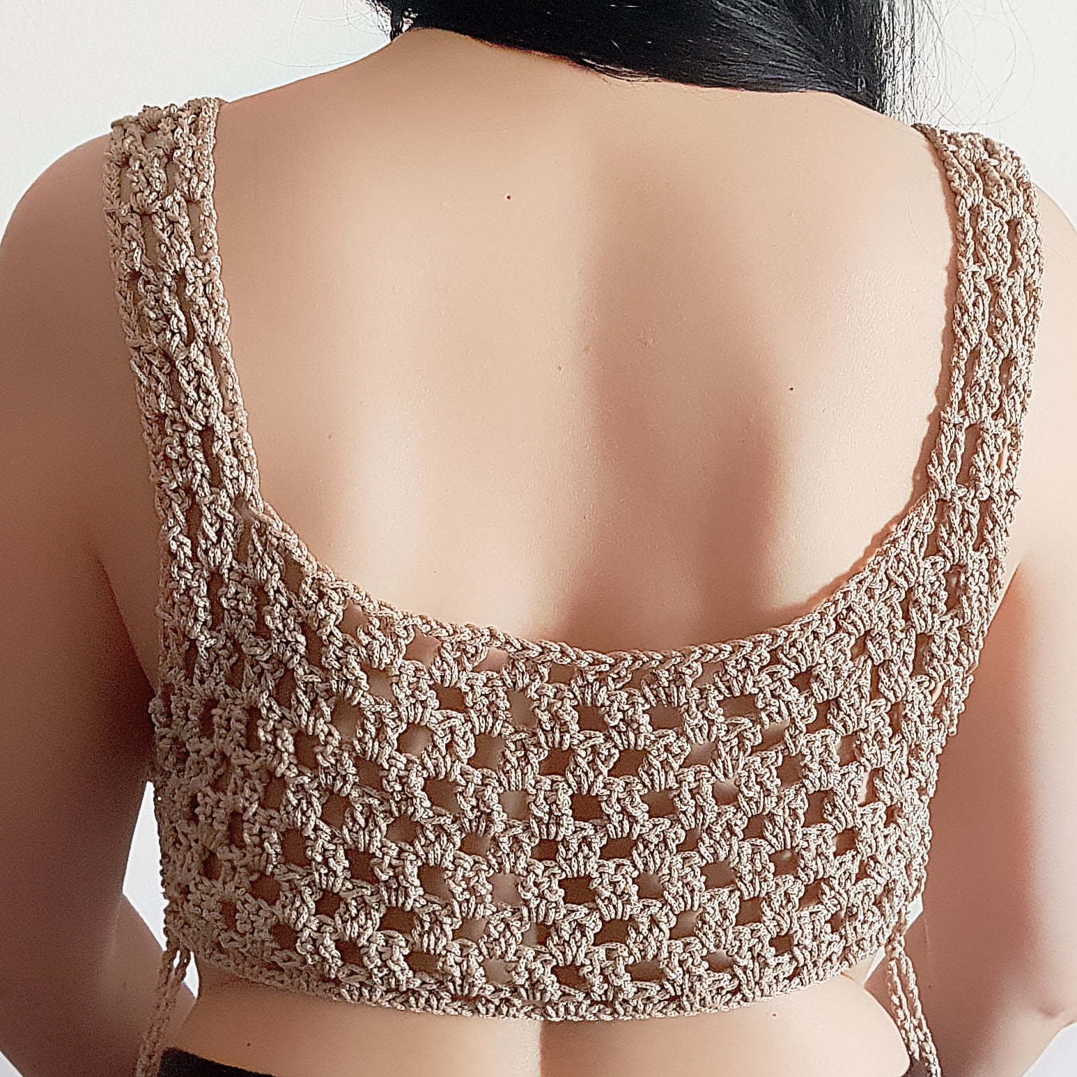 Nude crochet sexy handmade crop top 4 this crochet top was created with comfort and uniqueness in mind. Handmade top created to be a unique one of a kind clothing item. It is perfect for several sizes as you can tie-up the sides looser or tighter for a perfect and comfortable fit. A great crochet top with a modern color. Great as a casual top or with smart pants or a skirt, accessories and shoes for a more smart casual occasion.