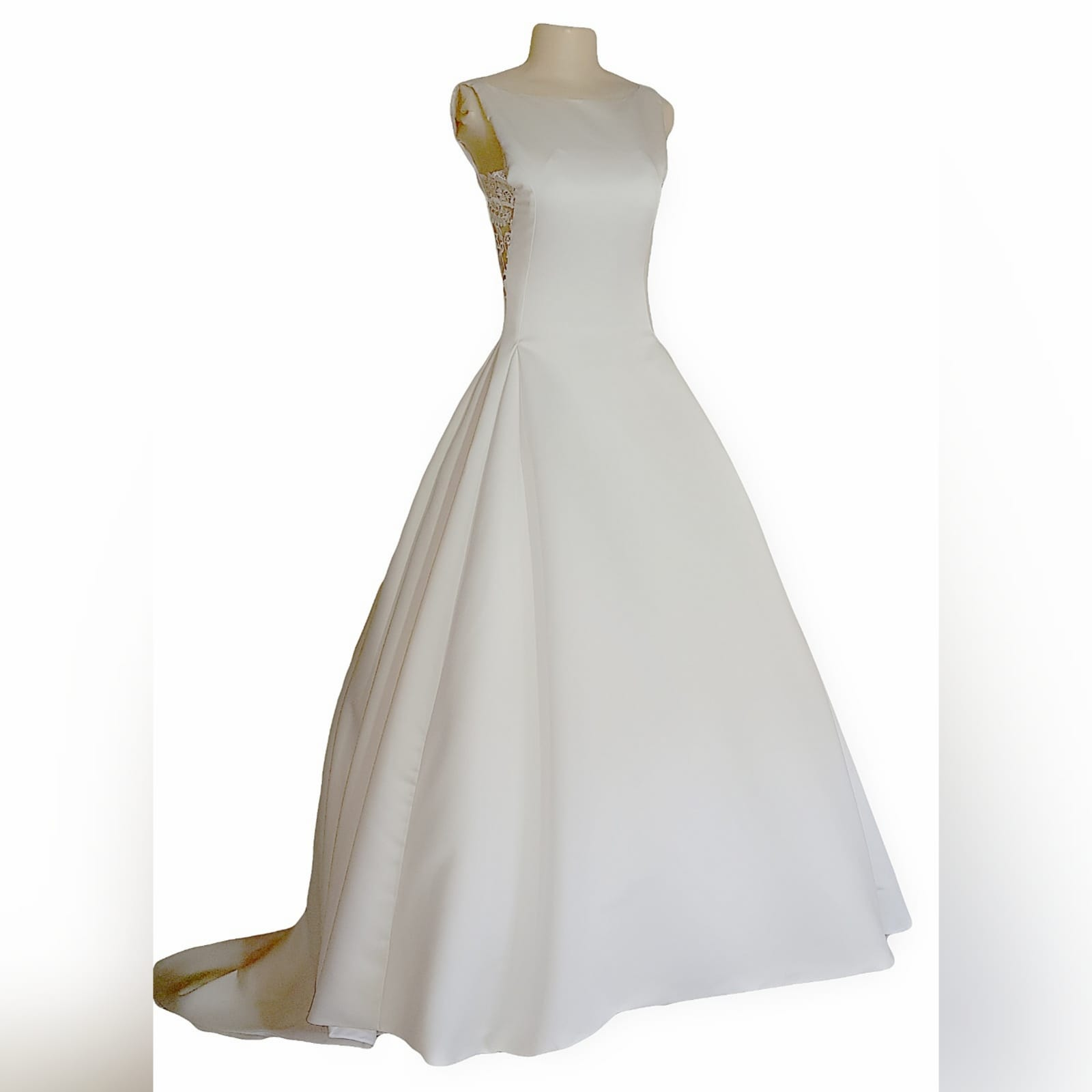 "Elegant satin wedding dress 4 <blockquote>""let yourself be drawn by the stronger pull of that which you truly love. "" rumi</blockquote> a gorgeous, elegant satin wedding dress created especially for my client. A classy fit with a bateau neckline, lace back and sides. Buttons all the way down till the edge of train adding that extra touch of sophistication. Designed with pockets to make life easier for the bride on her special day"