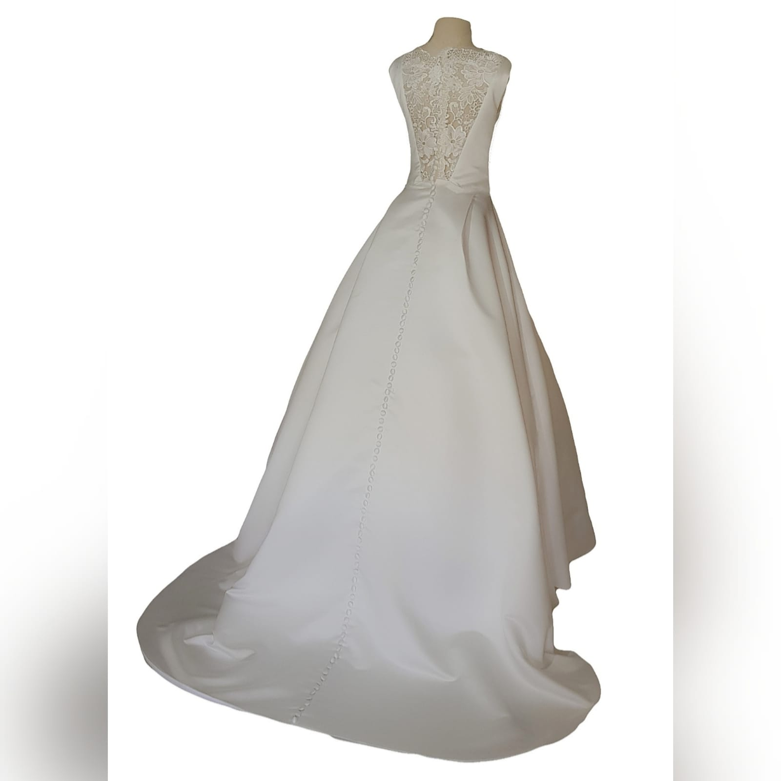 "Elegant satin wedding dress 6 <blockquote>""let yourself be drawn by the stronger pull of that which you truly love. "" rumi</blockquote> a gorgeous, elegant satin wedding dress created especially for my client. A classy fit with a bateau neckline, lace back and sides. Buttons all the way down till the edge of train adding that extra touch of sophistication. Designed with pockets to make life easier for the bride on her special day"
