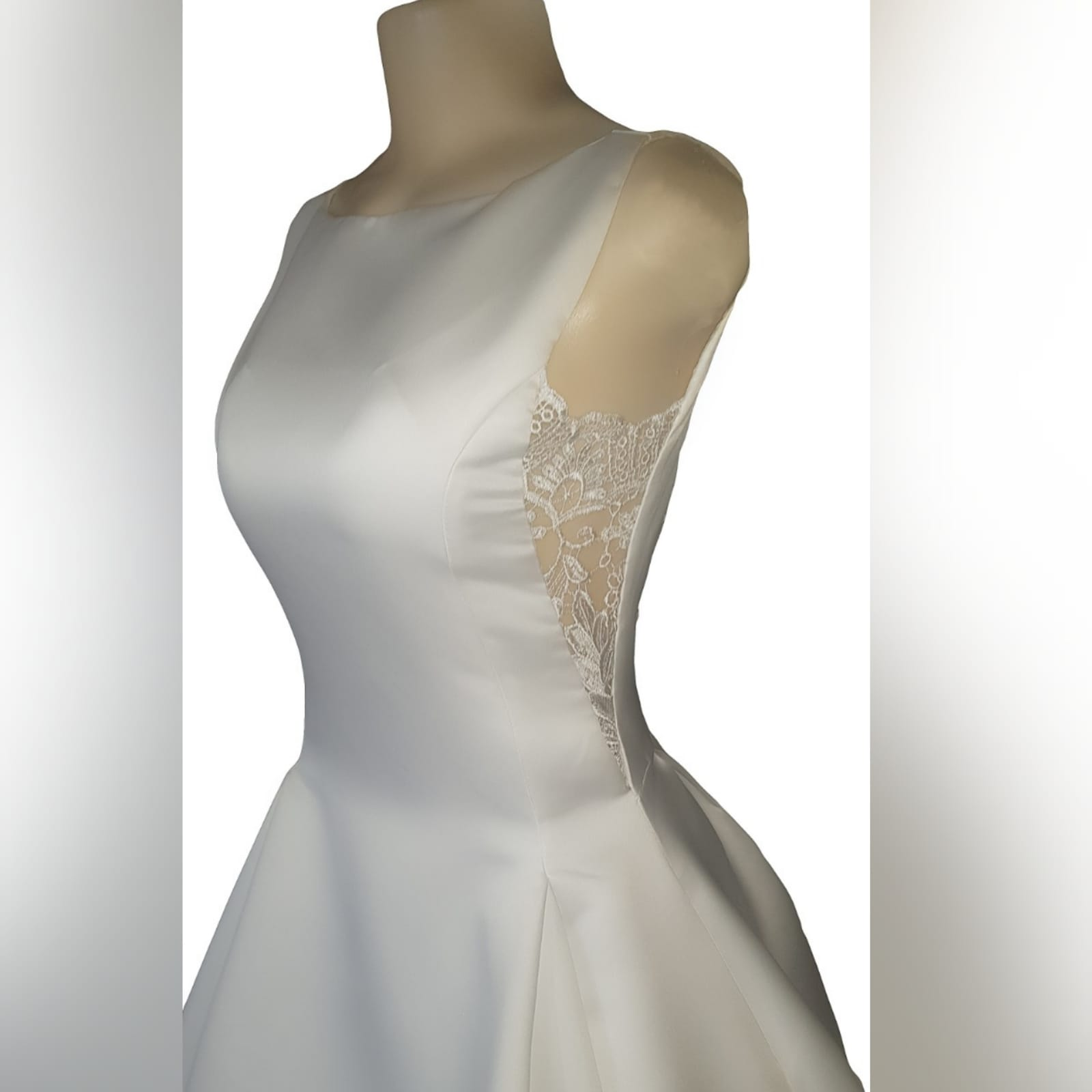 "Elegant satin wedding dress 7 <blockquote>""let yourself be drawn by the stronger pull of that which you truly love. "" rumi</blockquote> a gorgeous, elegant satin wedding dress created especially for my client. A classy fit with a bateau neckline, lace back and sides. Buttons all the way down till the edge of train adding that extra touch of sophistication. Designed with pockets to make life easier for the bride on her special day"