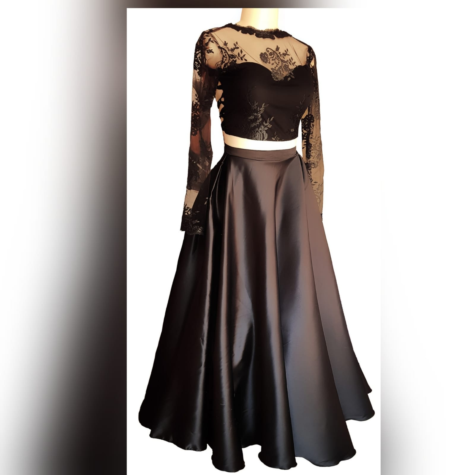 "Gorgeous and fun 2 piece black dress 3 <blockquote>""be yourself; everyone else is already taken. ""oscar wilde</blockquote>this gorgeous and fun 2 pieces black dress was created for a special occasion. Make memories with this luxurious satin wide skirt and a lace top with sheer neckline and sleeves and a tie-up back. Attend your ceremony looking formal and chic, then change the skirt to a part of pants or jeans for the after-party."