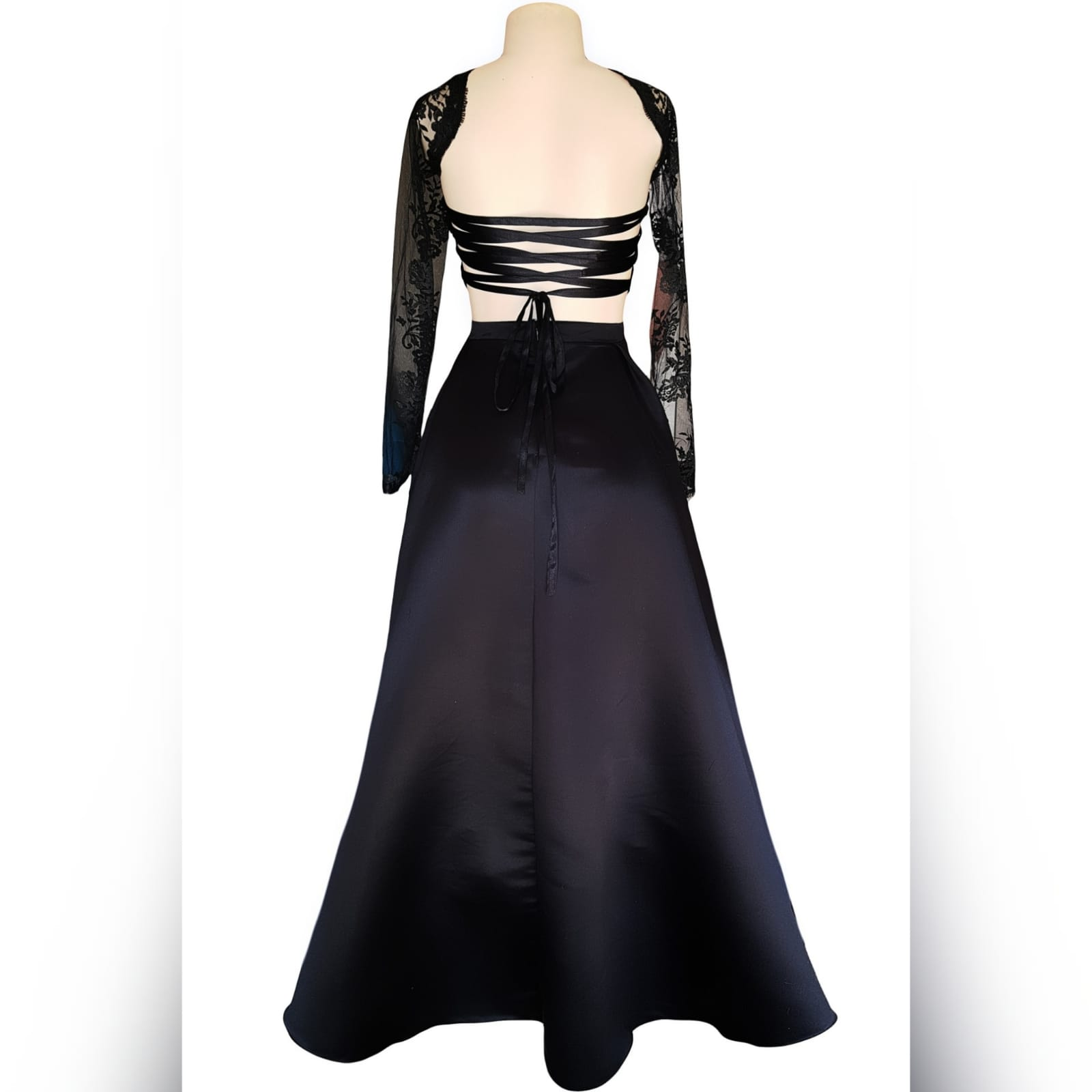 "Gorgeous and fun 2 piece black dress 7 <blockquote>""be yourself; everyone else is already taken. ""oscar wilde</blockquote>this gorgeous and fun 2 pieces black dress was created for a special occasion. Make memories with this luxurious satin wide skirt and a lace top with sheer neckline and sleeves and a tie-up back. Attend your ceremony looking formal and chic, then change the skirt to a part of pants or jeans for the after-party."