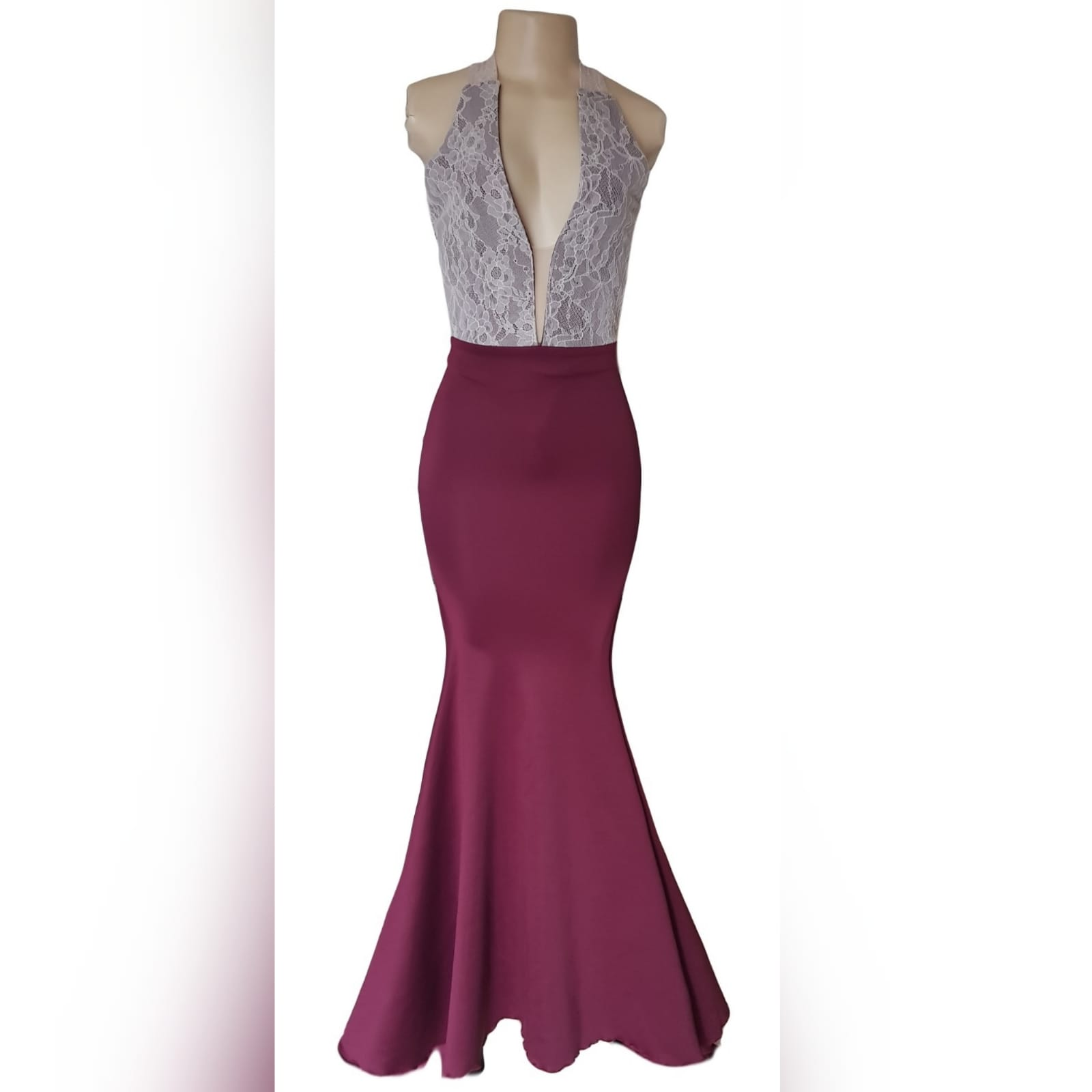 "Simple elegant soft mermaid maroon prom dress 1 <blockquote>""you were born to stand out, stop trying to fit in"". Roy t. Bennett</blockquote> simple elegant soft mermaid matric prom dress with an overlayer of cream lace on the bodice to add a unique touch to the design. Plunging neckline, low open back and lace wide crossed shoulder straps. With a matching lipstick/cellphone bag"
