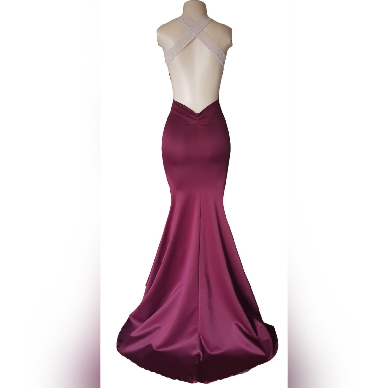 "Simple elegant soft mermaid maroon prom dress 4 <blockquote>""you were born to stand out, stop trying to fit in"". Roy t. Bennett</blockquote> simple elegant soft mermaid matric prom dress with an overlayer of cream lace on the bodice to add a unique touch to the design. Plunging neckline, low open back and lace wide crossed shoulder straps. With a matching lipstick/cellphone bag"