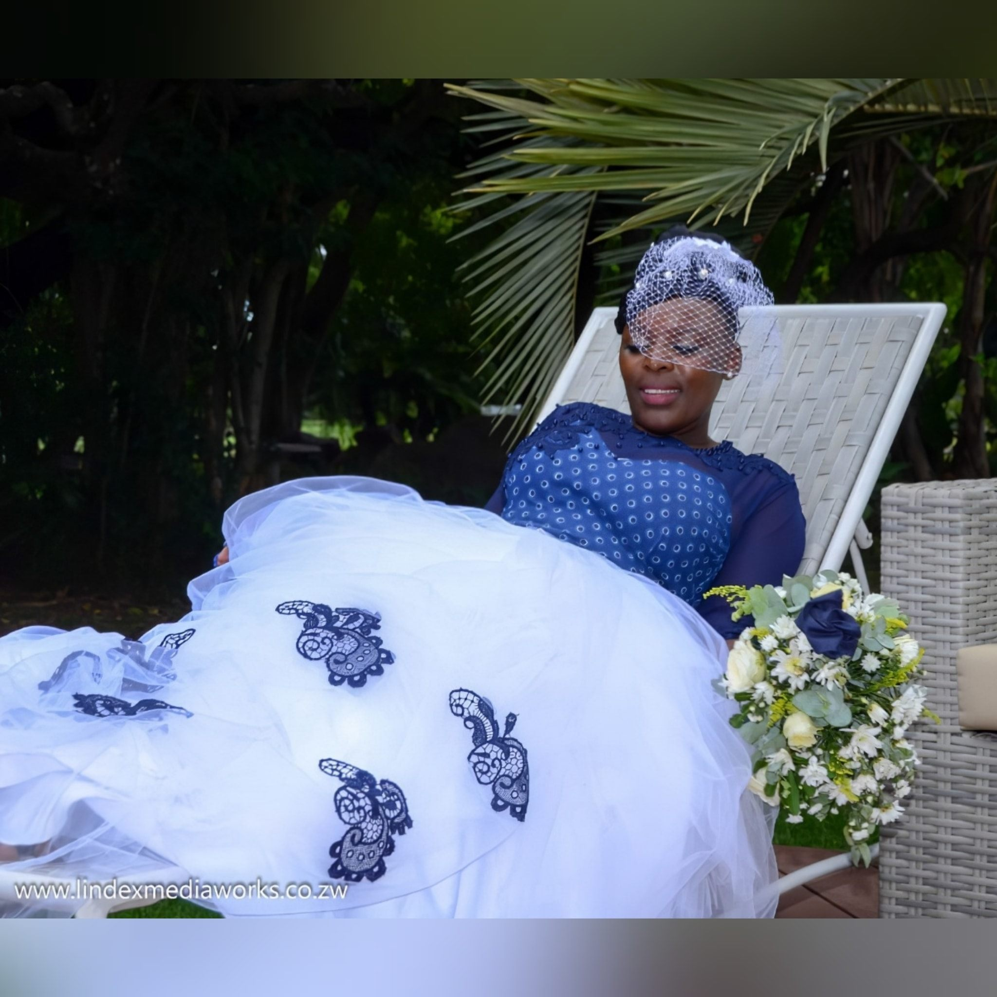 Modern african traditional wedding dress with lace, beads and pearls 9 modern african traditional wedding dress created for my client's special day. With a traditional blue bodice print detailed with lace, beads and pearls. White tulle bottom with a touch of blue lace detail. With an illusion neckline and sleeves. And a birdcage veil. #weddingdress #africanweddingdress #brides #traditionalbrides #passion4fashion #mariselaveludo
