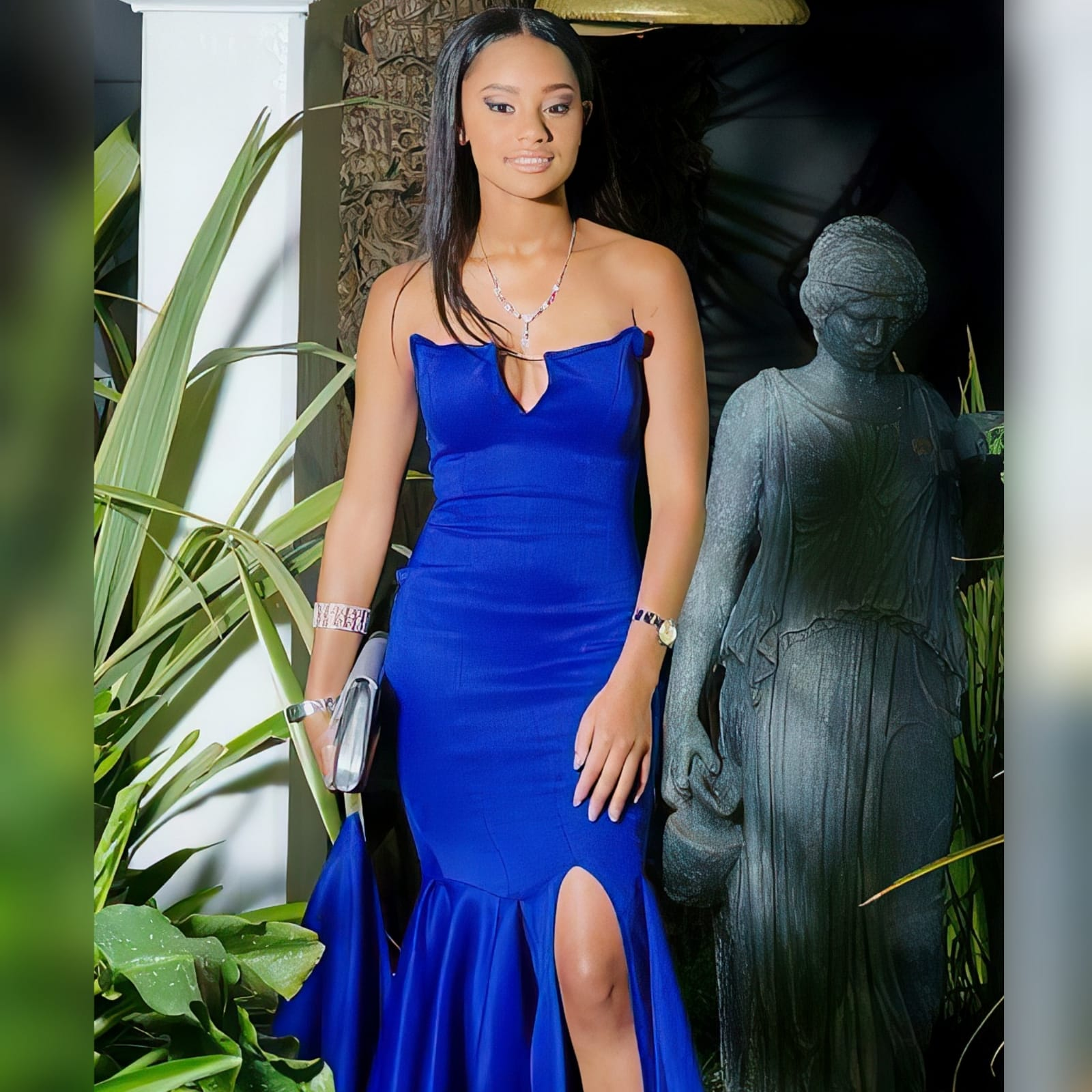 "Panelled royal blue mermaid prom dress with a knee length slit 3 <blockquote>""just remember to always be yourself and don't be afraid to speak your mind or to dream out loud. "" j. A. Redmerski</blockquote> this gorgeous piece that i designed and created for my client's special day, her prom dance, enhanced her figure by the way it hugs her physic. A panelled royal blue mermaid prom dress with a knee length slit and a double layer frill that becomes an elegant train. A slit on the bust line with a touch of detail with a diamante strap."