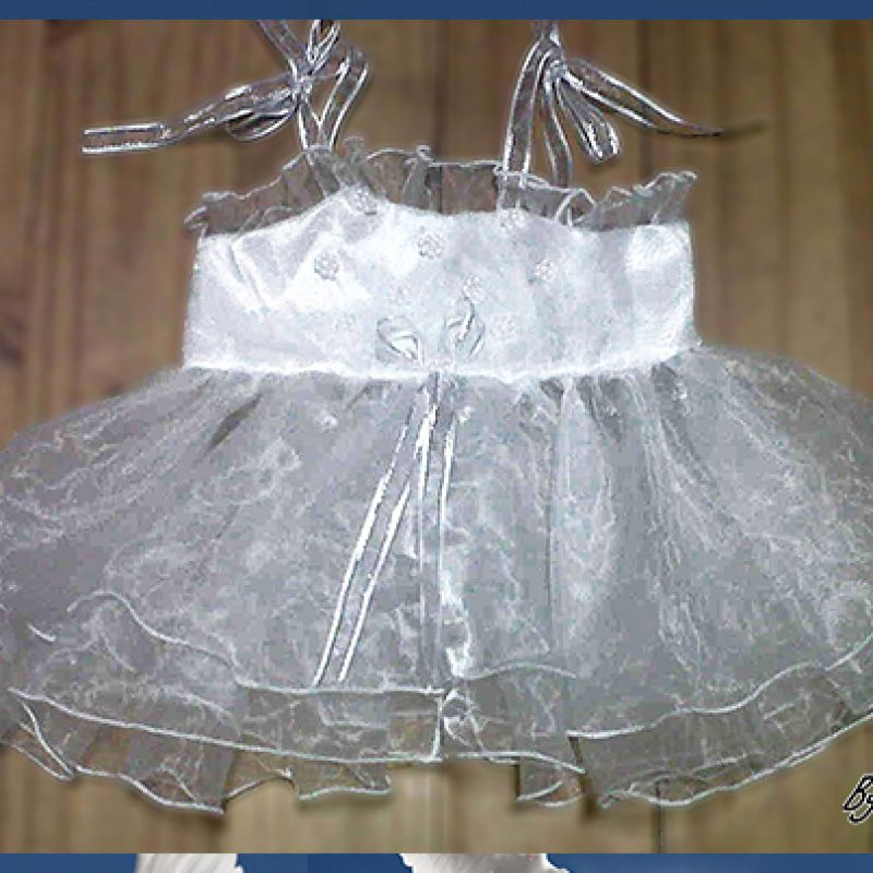 Christening/baptism dress made from crushed organza detailed with beaded flowers and silver detailed ribbon.